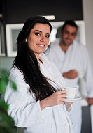 Young love couple taking fresh morning cup of coffee in the modern appartment