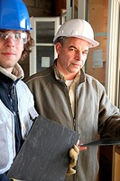 craftsman and apprentice working together