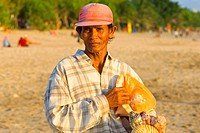 Beach vendor on Bali beach, Kuta, Indonesia