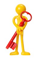 Miniature Figure with Key on White Background