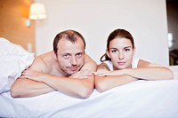 Young couple on the bed in the bedroom Photographed at interiors of The Jurys Inn Prague Hotel http://praguehotels jurysinns com