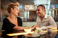 Smiling couple relaxing at bar