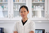 Serious Asian pharmacist