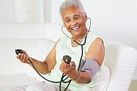 African American woman taking her blood pressure