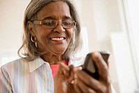 African American woman using cell phone