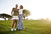 African American mother and daughter standing in park