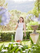 Woman taking pictures in garden