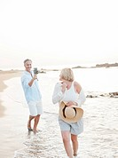 Man taking pictures of wife on beach