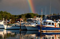 Fishing boats in harbor with rainbow, Ilwaco, Washington