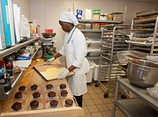 West Bloomfield, Michigan - Pastry chef Diane Smith prepares desserts for hospital patients in the kitchen of Henry Ford West Bloomfield Hospital