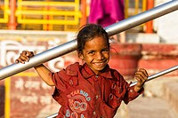 India, Uttarakhand, Rishikesh, Portrait of girl, smiling