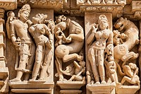 India, Madhya Pradesh, Erotic Scene on wall at Parshwanath Temple