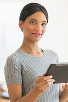 Portrait of woman holding digital tablet