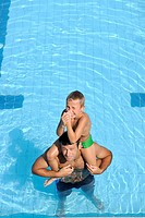 happy father and son have fun at swimming pool