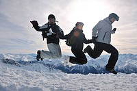 happy people group have fun on snow at winter season on mountain with blue sky and fresh air