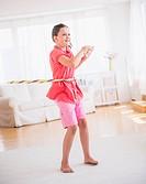 Young girl 8_9 playing with hula hoop