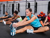 Multiracial group of two women doing aerobic in gym