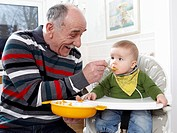 Grandpa feeding a child