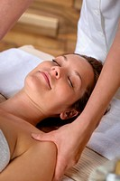 Woman neck massage at luxury spa