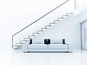 Interior in light tones with a sofa and a ladder o