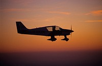 French plane Robin DR400-120 flying at dusk, France