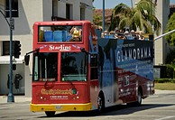 Hop on, hop off open-top sightseeing bus for tourists, Rodeo Drive luxury shopping street, Beverly, Hills, Los Angeles, California, United States of A...