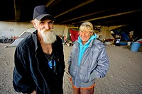 Homeless military veterans live under a Southern California bridge in jerry-built shelters A charitable veterans outreach program provides food and cl...