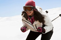 Caucasian woman skiing in snow