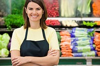 Caucasian worker in produce section of grocery store