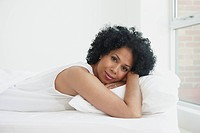 Black woman laying in bed