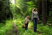 Mother and daughter in the forest