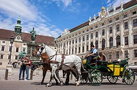 Tourists and Horse carriage in Hofburg Imperial Palace,Vienna, Austria, Europe