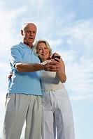 Mature couple looking at a cellphone