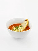 Bowl of Roasted Tomato Bisque with a Slice of Bread, White Background