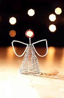 Christmas Angel decoration against background bokeh lights