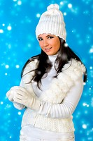 beautiful woman in winter fashion with snowball.
