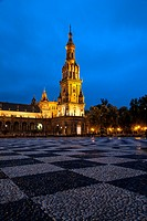 Night view of south tower and river at Plaza de España, Seville, Andalusia, Spain