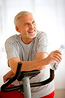 Man practising exercize bike.