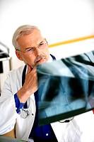 Doctor examining X_rays.
