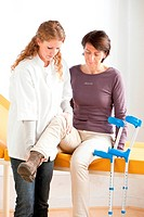 Physiotherapist examining a patient.