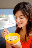 Woman eating muesli cereals.