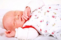 Cute newborn is sleeping peacefully