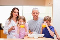 Smiling family having breakfast