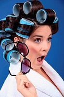 A stunned brunette with hairrollers on.