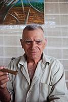Cuba, Pinar del Rio Province, San Luis, Alejandro Robaina Tobacco Plantation, older man with Cuban cigar, NR