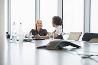 Businesswomen talking in office