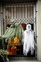 Halloween Ghost Dolls Decorating a Window of a New York City Town House