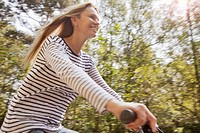 Blurred view of woman riding bicycle