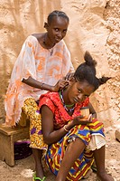 Ouagadougou, Burkina Faso: July 8, 2007. Fatimata Diallo, a Fulani woman, gets her hair braided by her cousin in Ouagadougou, Burkina Faso.