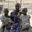 Near Akot, Sudan: February 25, 2006. Dinka children grow up in a cattle camp near Akot, South Sudan. South Sudan is still recovering from generations ...